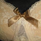 Olive bows on lace gore and straps. Band is also covered in lace
