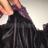 Backing is all black, including a layer of black stretch tulle behind the purple lace