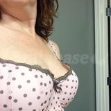 Left breast almost fills front of cup but notice gap at the side closest to arm