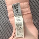 The bra's label showing brand and size.